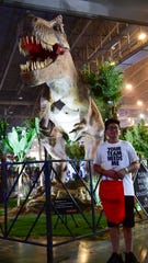 The Jurassic Quest tour features a fearsome T-Rex that stands about 12 feet tall.