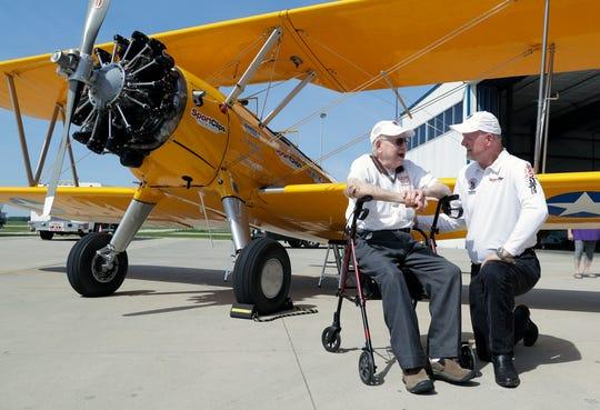 World War II Navy veteran Dutch Clark talks with Darryl Fisher, pilot and founder of Ageless Aviation Dreams Foundation, after taking a ride in an open cockpit, 1943 Stearman biplane on June 27, 2019 at Green Bay Austin Straubel International Airport in Ashwaubenon.