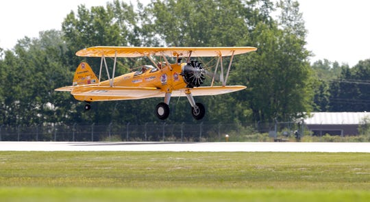Army veteran Wally Hilliard of Green Bay and Darryl Fisher, pilot and founder of Ageless Aviation Dreams Foundation, take off in an open cockpit, 1943 Stearman biplane on June 27, 2019, at Green Bay Austin Straubel International Airport in Ashwaubenon.
