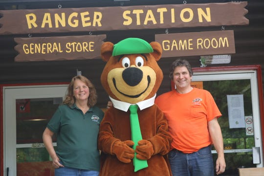 Jill and Jim Kravicky have opened and operated Door County Jellystone Park since 2002. Seen outside the general store and game room with camp symbol Yogi Bear, the park, the first in the Jellystone network, celebrates its 50th anniversary this weekend.