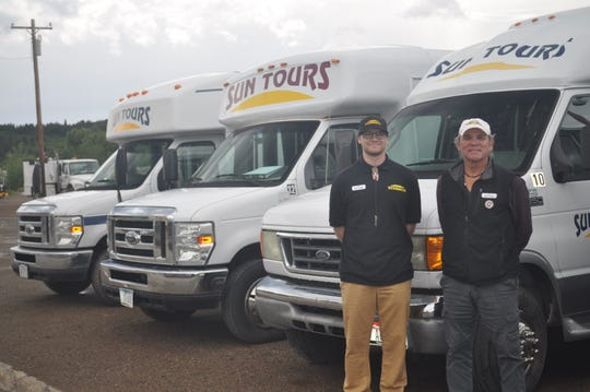 Ed DesRosier, right, and his son Derek, left, are among the executives in Sun Tours, an award-winning business at Glacier National Park.