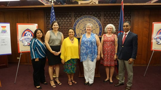 Gov. Lou Leon Guerrero with members of the newly sworn in Guam Ethics Commission on Thursday.