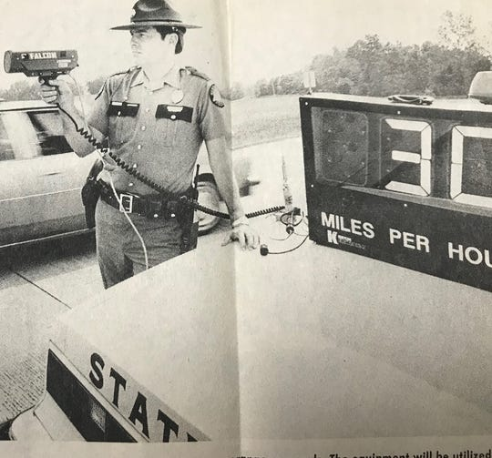 KSP Trooper Ed Brady running radar in 1984. The picture appeared in The Gleaner.