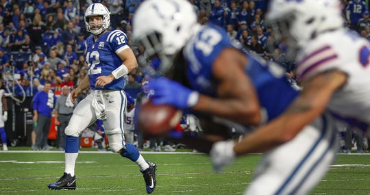 Indianapolis Colts quarterback Andrew Luck (12) watches as T.Y. Hilton (13) catches a touchdown pass in the second half of their game against the Buffalo Bills on Sunday, Oct 21, 2018. The Colts defeated the Bills 37-5.