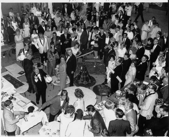 "Mementos from the Claypool Hotel were auctioned off during the ""ball before the fall"" in 1969, just before an explosion of fireworks at midnight beckoned the first swing of a crane-hitched wrecking ball to begin the hotel's demolition."