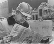 Demolition contractor Ed Zebrowski reads the June 13, 1908, copy of The News that was in the cornerstone of the old YWCA building that was being raised in the 300 block of North Pennsylvania Street on Feb. 3, 1977.