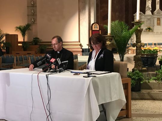 Archbishop Charles Thompson and Superintendent Gina Kuntz Fleming of Archdiocese of Indianapolis speak to media on June 27, 2019.