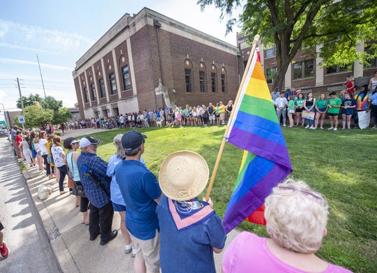 Students, alumni and supporters of the Cathedral High School community protested outside the headquarters of the Archdiocese of Indianapolis, Thursday, June 27, 2019, after the firing of one of that school's teachers who is involved in a same-sex marriage.