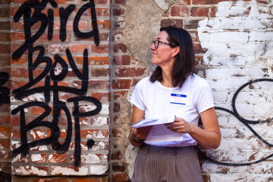 Nancy Bird, Executive Director of the Iowa City Downtown District, listens during a State of Downtown event, Wednesday, June 26, 2019, in an alleyway behind Discerning Eye in downtown, Iowa City, Iowa.