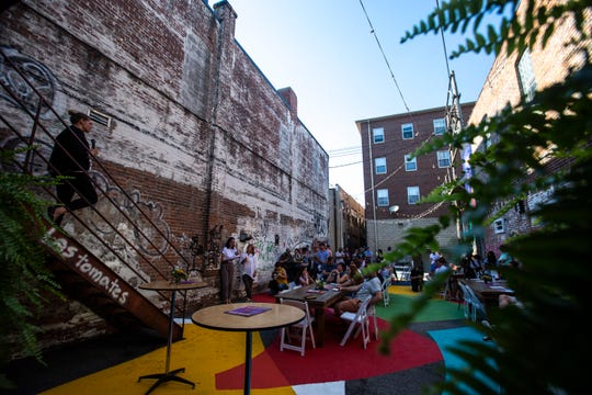 Betsy Potter speaks during the State of Downtown annual meeting, Wednesday, June 26, 2019, in an alleyway behind Discerning Eye in downtown, Iowa City, Iowa.