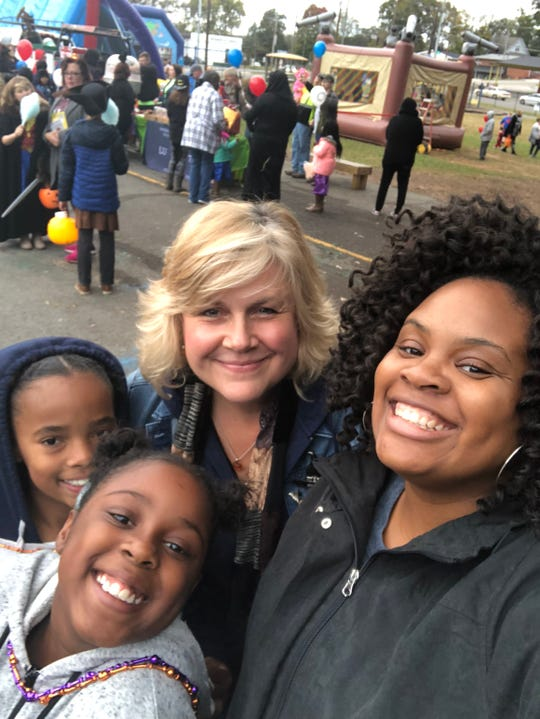 Porschia Pickett, right, of the Great Schools Partnership oversees the day of fun for families and kids in the community. She's shown here with Lynne Fitzpatrick, assistant principal of Belle Morris Elementary, and two of the school's students at the 2018 fall festival.