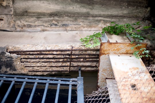 Rebar is exposed beneath the deteriorating Jackson Avenue ramp in Old City Knoxville, Tennessee on Tuesday, June 25, 2019. The ramp is planned for demolition later this summer.