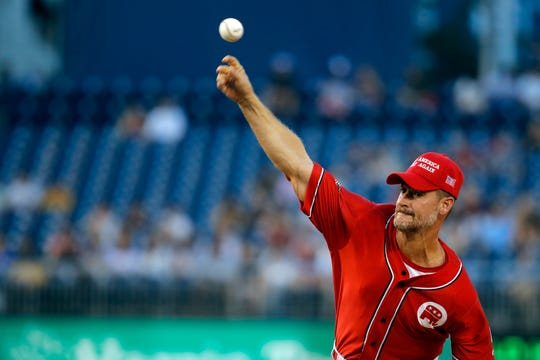 Pitcher Rep. Greg Steube, R-Fla., pitches during the first inning of the Congressional Baseball Game at Nationals Park in Washington, Wednesday, June 26, 2019. (AP Photo/Carolyn Kaster)