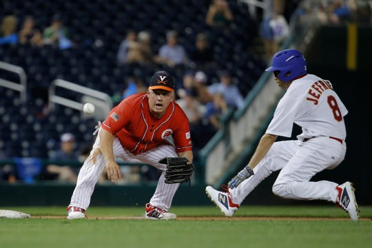 Rep. Denver Riggleman, R-Va., looks to catch a throw as Rep. Hakeem Jeffries D-N.Y., slides into third during the Congressional Baseball Game at Nationals Park in Washington, Wednesday, June 26, 2019. Democrats won 14-7. Riggleman missed the throw and Jeffries was safe on third. (AP Photo/Carolyn Kaster)