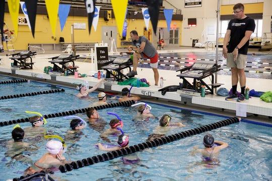 Alex Jerden coaches swimmers during a practice for Boilermaker Aquatics Swim Club, Wednesday, June 26, 2019 at Purdue University's Morgan J. Burke Aquatic Center in West Lafayette.
