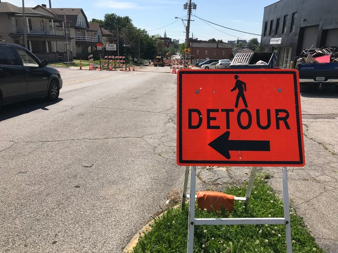Detour signs greet pedestrians and drivers on Main Street, as crews work on a drainage project between 11th and 12th streets. The detour is expected to last until July 12.