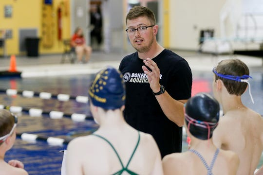 Coach Alex Jerden speaks with swimmers during a practice for Boilermaker Aquatics Swim Club, Wednesday, June 26, 2019 at Purdue University's Morgan J. Burke Aquatic Center in West Lafayette.