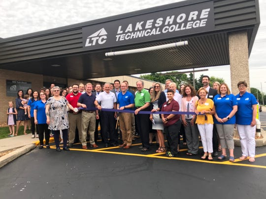 LTC President Dr. Paul Carlsen leads the ribbon cutting in front of the new Lakeshore Technical College Manitowoc campus at 600 York Street.