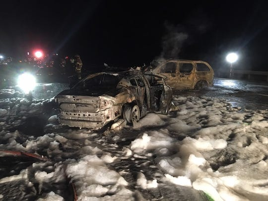 The Ohio Highway Patrol car and the suspect's vehicle both caught fire after the crash.