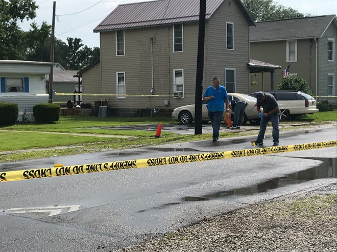 Marion Police Major Jay McDonald processes the scene of a shooting in the 500 block of East Mark Street, near the intersection with Ivanhoe Street.