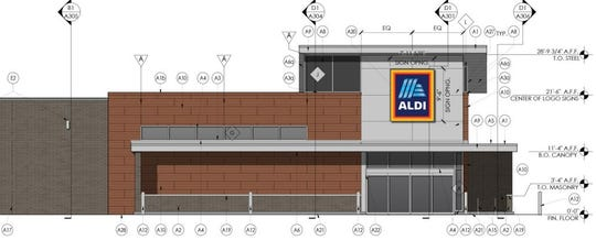 A portion of a preliminary development plan shows the proposed exterior of an ALDI in Lakeland.