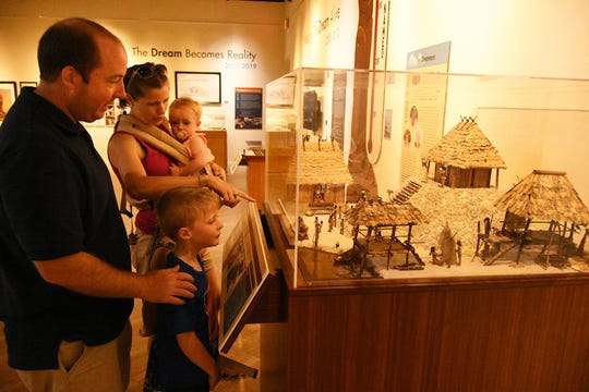"Jeff and Chelsy Weber of Maryland look over displays in the Marco Island Historical Museum's ""Building a Dream"" exhibit."