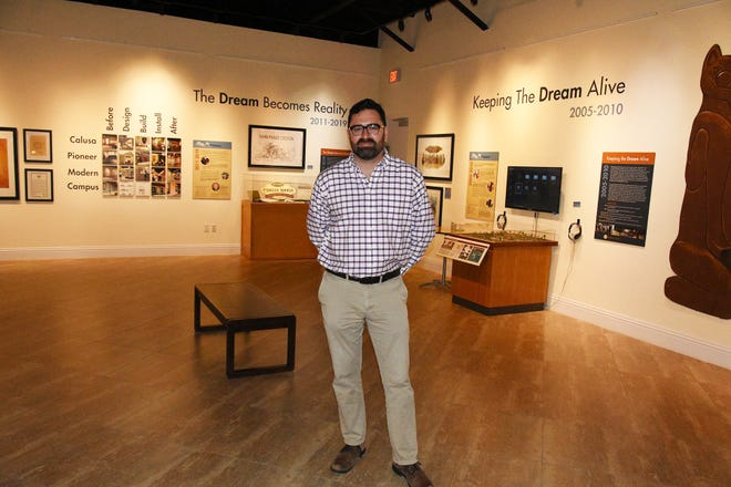 Austin Bell, curator of collections for the Marco Island Historical Society, with an exhibit telling the history of the historical society. Bell has been tapped for a consulting scholarship for the University of Pennsylvania Museum of Archaeology and Anthropology.
