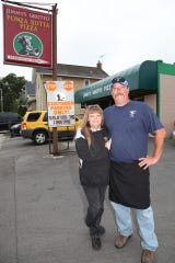 Doug and Holly Ciampa stand outside their restaurant, Jimmy's Grotto, in this undated, but recent photo. Doug died June 26 following emergency surgery for a brain aneurysm he suffered the previous day.