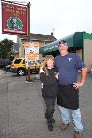Doug and Holly Ciampa stand outside their restaurant, Jimmy's Grotto, in this undated, but recent photo. Doug died June 26 following emergency surgery for a brain aneurysm he suffered the previous day. The family has carried the business forward in the four months since Ciampa's death.