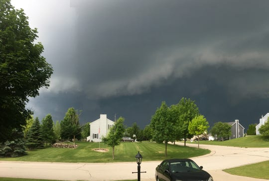 Thunderstorm clouds move over Germantown in Washington County late Thursday afternoon.