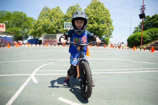 Kelby Renk from Milwaukee tries out the Harley-Davidson¨ Electric Powered Two-Wheeler Demo on Thursday.