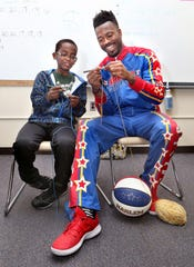 Jonah Larson got the opportunity to teach the Harlem Globetrotters to crochet.