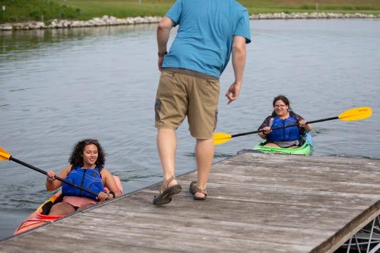 Festival goers enjoy free kayak rides through L.L.Bean.