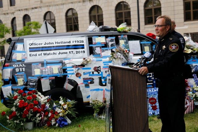 Kenosha County Sheriff David Beth holds a news conference outside the Racine Police Department on Thursday to announce an arrest in the fatal shooting of Racine Police Officer John Hetland.