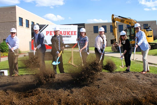 The Pewaukee School District breaks ground for a series of projects that will be paid for by a November 2018 referendum. They are scheduled for completion by the start of the 2020-21 school year. Pictured are (from left) Mike Dietrich, Mark Lillesand, Pewaukee Schools superintendent Mike Cady, Pewaukee Chief Academic Officer Danielle Bosanec, Pewaukee Assistant Superintendent/Chief Financial Officer John Gahan, Agatha Vonderberg and Nathan Schieve.