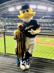 Jonah Larson crocheted a scarf for Bernie Brewer.