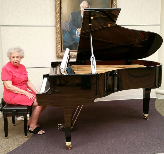 Jeannie Alley is shown at a Baldwin grand piano she donated to Baxter Regional Medical Center. An accomplished pianist and music lover, Alley believes in the restorative power of music.