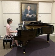 Volunteer Olivia Wolfe plays the piano on Thursday afternoon at Baxter Regional Medical Center. Music who are interested in playing music for the music ministry at BRMC should contact Jeanne Alley through the hospital foundation office at (870) 508-1770.
