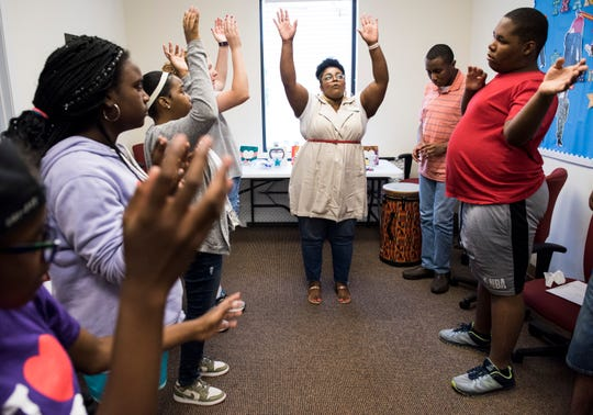 Jocelyn Stovall of Evolve Music Therapy dances with special needs students in Montgomery, Ala., on Thursday, June 27, 2019.