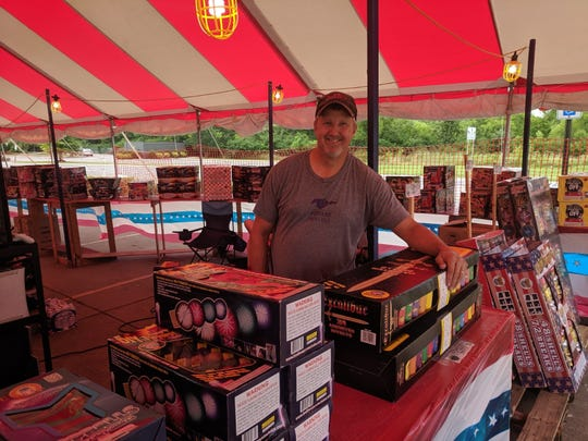 Todd Cunningham stands by Excalibur fireworks at his tent on West Nir Schreibman Boulevard that he runs through Mid America Distributors. He has worked as a private contractor with fireworks companies for 13 years.