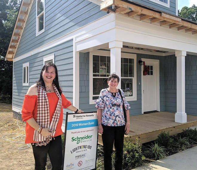 Maria Herrera and her mother Estella pose in front of their new home in the Willow Crest subdivision in Fairview. Finishing touches will be put on the home in the next week, and the family will move in by the end of June.