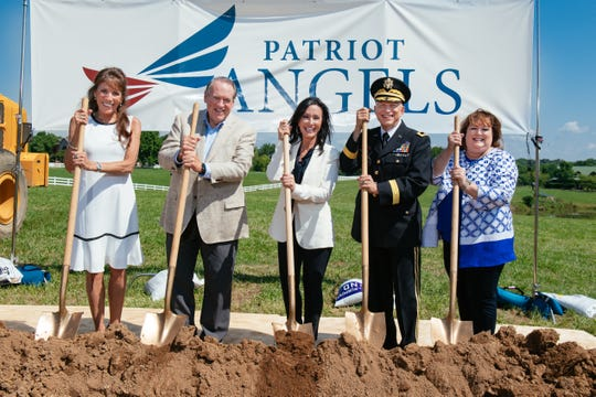 Gallatin Mayor Paige Brown, former Arkansas Gov. Mike Huckabee, Suzette Graham, Maj. Gen. Daniel York and Brookdale Senior Living Executive Vice President Mary Sue Patchett break ground at the new Gallatin location of Patriot Angels.