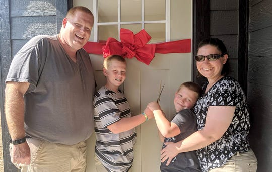 The Alejandro family cuts the ribbon to their new home June 15, 2019.