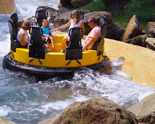 A small group can ride Raging Rapids together at Holiday World.