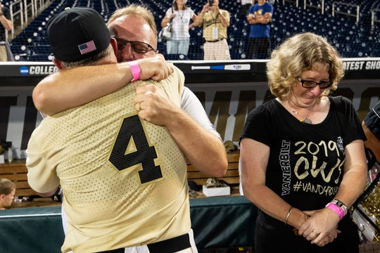 Vanderbilt head coach Tim Corbin greets Teddy and Susan Everett, parents of Donny Everett, after Vanderbilt defeated Michigan in game three of the 2019 NCAA Men's College World Series Finals at TD Ameritrade Park Wednesday, June 26, 2019, in Omaha, Neb.