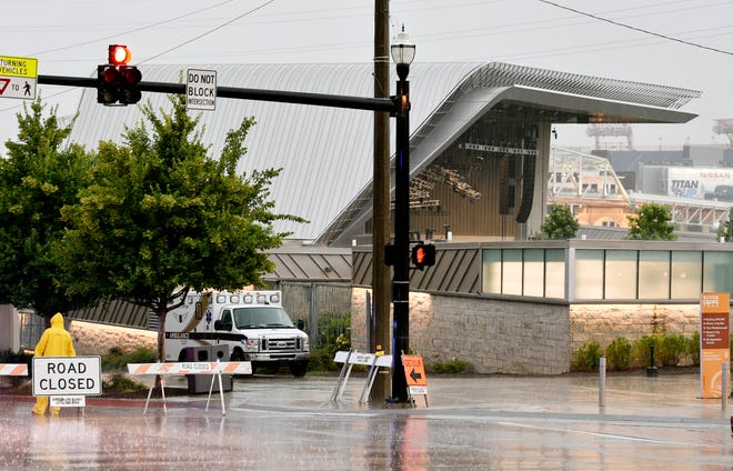 Rain pours down outside Ascend Amphitheater, where the Peter Frampton concert was delayed and then rescheduled due to weather Thursday.