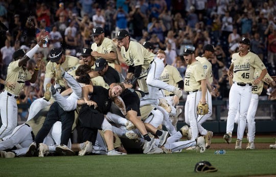 Vanderbilt celebrates its 8-2 win over Michigan during game three of the 2019 NCAA Men's College World Series Finals at TD Ameritrade Park  Wednesday, June 26, 2019, in Omaha, Neb.