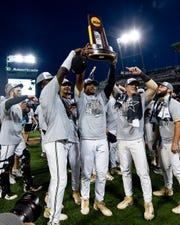 Vanderbilt players celebrate with their trophy after their victory Wednesday.
