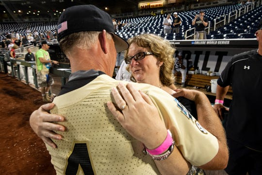 Vanderbilt coach Tim Corbin hugs Susan Everett, mother of Donny Everett, after Vanderbilt defeated Michigan at the College World Series on Wednesday.
