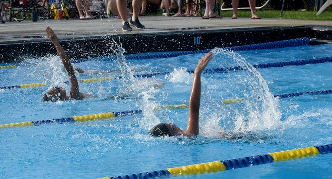 Eli Harris and Gabe Harris, shown here earlier this season, were a part of two record-setting relay teams during the Tri-County Aquatic League championships, helping the Pataskala Porpoises to a runner-up finish.